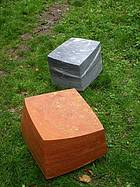 Two sitting stones from travertine and marble