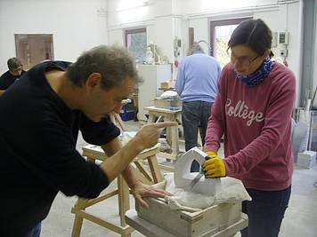 Helle sanding, shortly before finishing her sculpture